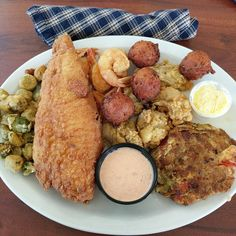 [I Ate] Fried Oysters Flounder Shrimp and Okra with Hush Puppies and a Crab Cake.