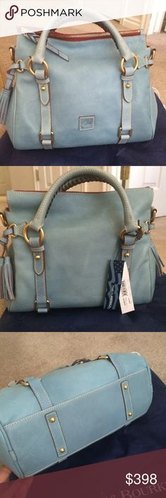 """Dooney & Bourke Small Florentine Satchel NWT  Dooney & Bourke rare color Dusty Blue  Florentine Small Satchel Style 8L98B W/ dust bag. Made from rich, luxurious Italian leather. Double handles, adjustable shoulder strap, leather logo patch, side tasssels, top zip closure, and four bottom feet Lined interior, back-wall zip and slip pockets, two front-wall slip pockets, Bag 13""""W x 8""""H x 5-3/4""""D; Handles 4-1/2""""; Strap drop 22-1/2"""" to 24-1/2""""; weighs approximately 2 lbs, 8 oz Body/trim 100%…"""