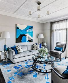 A generously sized rug will make the room feel bigger by accentuating a larger footprint. I position large sofas partially on the rug and armchairs entirely on the rug, which visually pulls together the furniture into a well grounded grouping - Brendan Wong