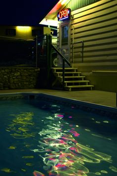 I love how the neon sign and every light has its own ripple in the pool and every color is distinguished in the blue water. #U4APSA