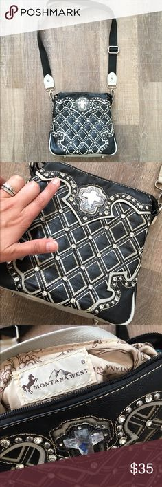 Montana West Purse Montana West crossbody purse with bling detail and cross.  In great condition other than missing one brad (see picture)  Adjustable strap and lots of pockets!  Feet on bottom to protect fabric.    Great for travel or everyday! Montana West Bags Crossbody Bags