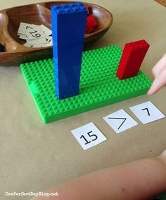 This post is not in English, but this picture says it all.  What a great strategy, especially for students with special learning needs.  Not only will students get practice with 1:1 correspondence counting out the legos, but will also have a great visual for practicing greater and less than.
