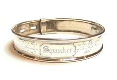 Spanker: A George IV silver dog collar. Made by Samuel Horton, 1824