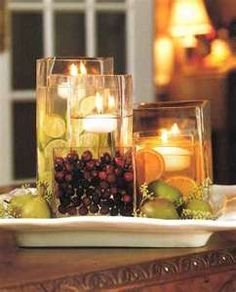 Simple centerpiece idea: buy several of the same vase in different sizes; fill one with nuts, one with whole cranberries, one with sliced or whole oranges, limes and lemons...use your imagination.