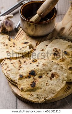 Homemade indian naan bread with garlic sauce, simple and delicious