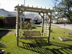 Wooden Swing.. Would love to have one of these in the garden area of our backyard.