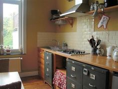 I don't think I would ever do this (not my style), rethinking using filing cabinets in the kitchen is brilliant.