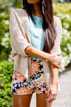 Baby blue top, floral high-waisted shorts, beige cardigan
