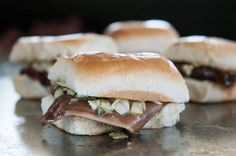 "SMOKES AND EARS: The Big Apple Inn's pig ear sandwich with cabbage slaw. the Big Apple Inn — an institution of old-school Southern sandwiches from Jackson, Miss. — has arrived in Atlanta. The original Big Apple Inn was founded in 1939 by Juan ""Big John"" Mora, who made his way from Mexico to Mississippi. The lasting legacy of the Big Apple has been the smokes and ears that came later on, a product of Mississippi as seen through the eyes of a Mexican immigrant and his African-American wife."