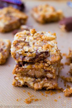 Caramel Snickers 7 Layer Bars. » Sallys Baking Addiction | Recipe for 7 layer magic bars with Snickers, caramel, peanut butter, nuts, and chocolate chips.
