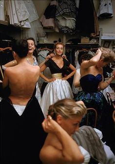 behind the scenes @ Pierre Balmain, 1954. look @ all those dresses hanging up on the wall. they are having such fun being women!