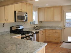 bianco romano granite with natural maple - Google Search