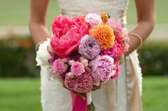 bright pinks, purples, and oranges in this bouquet from Twigg Botanicals // photo by SundayRomance.com