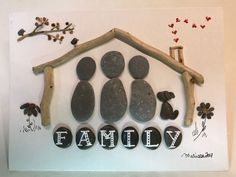 Pebble art, family portrait in a driftwood house.