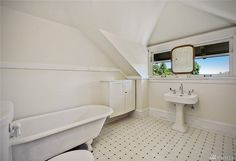 Dealing with a bathroom under the eaves/ideas for our master. 1906 Capitol Hill. 955 16th ave E. like the window for lots of light, old sink and tub. Floor tile pretty ugly and cabinet & mirror are awkward but salvagable.