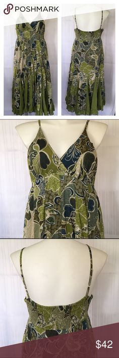"NWOT gorgeous green & blue hippie summer sundress NWOT gorgeous green & blue hippie summer sundress with white & brown paisley accents. New condition, never worn. 100% cotton. Plus size 3X by Magic. Adjustable straps and smocked elastic back make for a custom fit. Bust 44""-52"", empire (high) waist 40""-44"", hips 64"" max. I'm a 40G and, although the bust fits, the cups are too small for my comfort. 46"" long from armpit to hem. 🚫No holds 🚫No Lowball Offers 🚫No Trades ✅Please submit reasona"