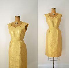 1950s Gold Wiggle Dress / 50s Cocktail Dress. $138.00, via Etsy.