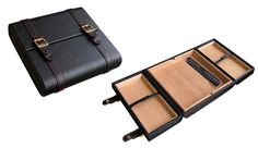 Augustus Black Leather Travel Humidor.Capacity for 20 cigars, black leather with matching straps and gold buckles , spanish cedar lining, accented with rich leather stitching. My next gift to myself.