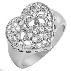 "CZ Ring with Hearts & Flowers Crafted in Solid .925 Sterling Silver, SIZE 8 ONLY $43.99  Crafted in Solid .925 Sterling Silver, Hallmarked 925. 23 round clear CZs set in a high quality solid sterling silver heart setting with ""cut-out"" flowers. .60CTW.  15mm width Shank tapers down to a 4mm width.     4.4 Grams Total Item Weight     Arrives in a gift box with a keepsake velour pouch! Unique and Simply AWESOME !!!  Rises 6mm off the finger."