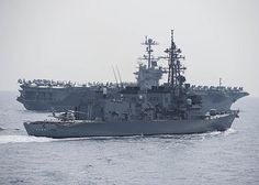 The aircraft carrier USS John C. Stennis (CVN 74) and Japanese Maritime Self-Defense Force Murasame-class destroyer JDS Akebono (DD 108) steam in formation.