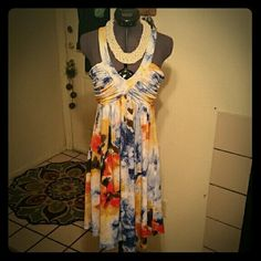 Beautiful Summer Dress Awesome dress, excellent condition.  Perfect for summer with a cute pair of sandals or strappy wedges!  Has a mix of colors with shades of blue, yellow, brown, red, white! Calvin Klein Dresses Midi