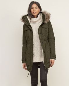 Womens A&F Sherpa Lined Military Parka | Military-inspired, warm and comfortable, lined with cozy sherpa, made from water resistant fabrication, featuring fleece lined pockets, removable faux-fur, a button and zipper closure, finished with drawstring hem | Abercrombie.com