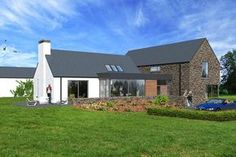 Contemporary house in Cavan, influenced by traditional rural architecture. The house is broken into a series of individual blocks representing the traditional cottage and associated outbuildings. The building is clad in natural stone and render. Modern Bungalow House, Bungalow Exterior, Bungalow Renovation, Rural House, Bungalow Designs, Bungalow Ideas, House Outside Design, House Front Design, Modern House Design