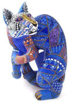 Zapotec cat | painted wood carving |  Mario Castellanos