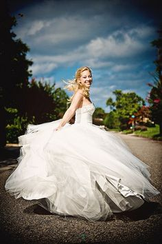 This is so pretty :) Great way to get a shot of the dress (maybe not in the middle of a street though)