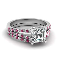 This magnificent wedding #ring set features a sparkling U prong set center stone, which is further highlighted by a series of shimmering floating prong set round cut #diamonds placed beautifully in a neat line on the split shank giving it an elegant appeal. http://jangmijewelry.com/
