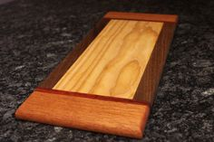 Cutting board made with Walnut, Mahogany, Walnut, and Ash