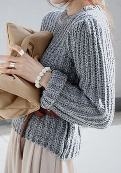 grey, belted sweater.