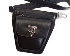 This black leather hip bag allows you to travel hands-free in style. Features full-grain cowhide leather and high quality metal closures, including a vintage-style swing lock. Whether youre heading to the festival event of the year, exploring a new city or taking your wee one to the park, youll be sure to have all your essentials on hand. The zippered front pocket can fit a large cellphone such as an iPhone 6, and the main pocket with flap is large enough to fit all your other essentials…