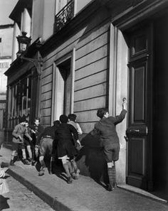 Robert Doisneau - Ring the doorbell and run.  We all have done it.