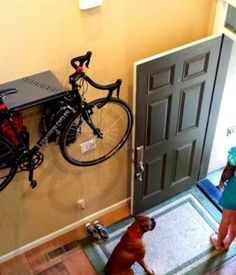 This smart metal rack mounts on a wall and holds your bike by the frame, plus has hooks for all of your accompanying gear in a small foot... http://www.kickstarter.com/projects/1931503509/bike-dock-a-hideaway-bike-storage-rack-by-max-mfg