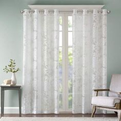 Transform your living space into a tropical retreat with the Madison Park Leilani Grommet Top Window Curtain Panel. The stunning panel combines an intricate burnout palm leaf pattern on a light and airy white sheer fabric for a relaxed and casual look. Window Sheers, Sheer Curtain Panels, Sheer Curtains, Panel Curtains, Leaf Curtains, Grommet Curtains, Living Spaces, Living Room, Thing 1