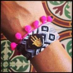 Clashing patterns with our #danalevy enamel hamsa token pom pom maxi friendship bracelets