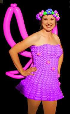 Purple balloon dress with pink wings. Very intriguing balloon art work. I wouldn't wear it but definitely worth looking at. Woman's fashion