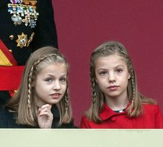 Princess Leonor (L) and Princess Sofia attend the National Day Military Parade 2016 on October 12, 2016 in Madrid, Spain.