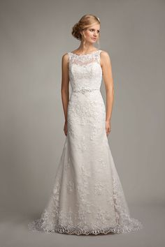 Mark Lesley 7156 Bridal Gown is a fairy tail fit and flare A-Line wedding gown with floaty lace skirt and sophisticated sweetheart and illusion neckline, it is adorned with a beautiful patterned lace overlay