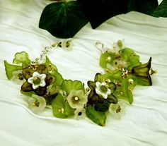 """'Irish Eyes Bracelet' is a Celebration of Green by K for """"Trifles & Whimsy"""" on Etsy.      Swarovski Crystal, Belles of Ireland, Lily of the Valley & Trumpet Lilies,  Baby's Breath."""
