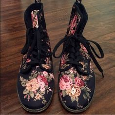 Rare floral doc martens flower print black doc martens! Perfect condition, no scruffs, rips, or scratches! They are rare and no longer made and never been worn. Canvas material, no heal. Price is firm bc of posh fees&retail price is $130! Will go lower on Merc! Doc martens  Shoes Ankle Boots & Booties