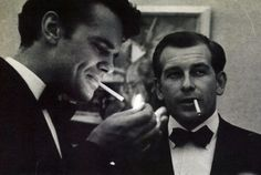 Charles Eames & Eero Saarinen. Eames is lighting up.