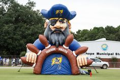 Giant Pirate!!!!  - Fairhope High School Pirate football team runs through the Pirate at every home game. - Fairhope Supply Co.
