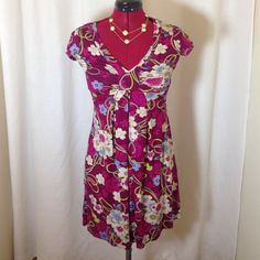 Kimchi Blue floral print short-sleeved dress Kimchi Blue from Urban Outfitters floral print short-sleeved dress. Very flattering silhouette with ruching in the front bust area. Gently loved and in excellent condition. No snags, marks, or tears in material. Size extra small but could fit small as well. Would look so cute with leggings and boots for fall/winter weather. Urban Outfitters Dresses