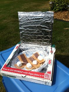 Make a pizza box oven with your kids! You can make s'mores without the campfire--all you need is sun. The pizza box solar ovens are quick and easy to make. Solar Oven Pizza Box, Solar Oven Diy, Diy Pizza Oven, Diy Solar, Oven Smores, Arrow Of Lights, School Age Activities, Solar Cooker, Easy Homemade Pizza