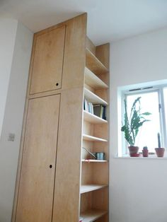 birch plywood shelving with integrated utility cupboard: