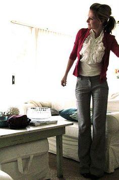 ruffled white blouse red cardigan grey pants