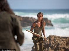 Alicia Vikander displays her athletic frame in Tomb Raider  She is set to hit the big screens as courageous herione Lara Croft for the latest Tomb Raider reboot.  And Alicia Vikander 29 displayed her incredible sporting ability in a series of promotional stills for the action-packed film as she is pictured taking on the characters signature bow and arrow and enduring a gruelling workout.  With a US release date of March 15 the Swedish actress  who plays the fierce protagonist  will fill in…