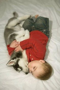 Adorable baby and puppy